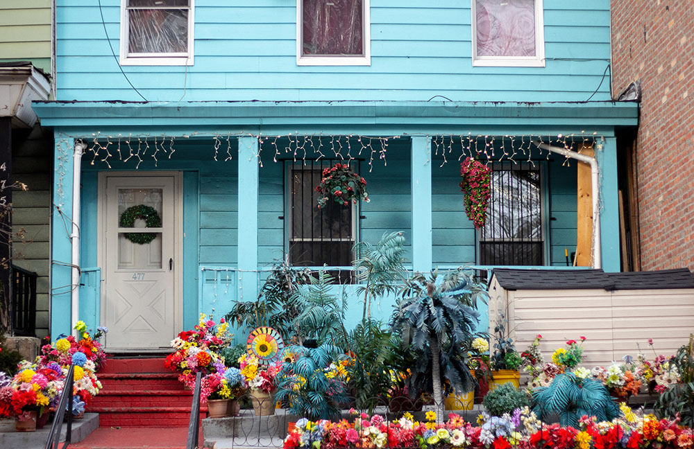 blue house with flowers out front